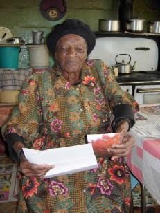 Norah Mhlongo receives a letter from her Vernon granny partner, Kathy Pratt.