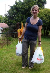 Belgian volunteer Benedicte Scheen carries a few of the 50 monthly supplementary food parcels.