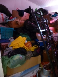 Accumulated clothing donations pile up