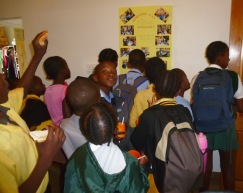 Some of the 50 kids in the Homework Program gather for a look at Susan's goodbye message in a photo poster.