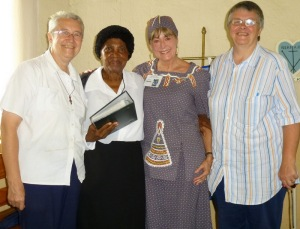 Presenting the photo album recording eight years of Grannies à Gogo fundraising for Sitabogogo, with Myriam Bryant, Cornelia Lukhele, Susan Fenner, Vicky Bryant.
