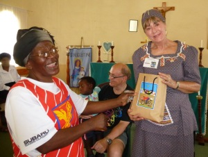 Paulina Ndlovu, Susan's writing partner, presents her with gifts from the gogos as they say goodbye after four weeks.