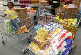 Shopping for 50 gogos fills four trolley wagons and two shopping carts