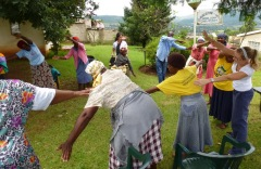 Physiotherapist Karen, far right, leads the gogos in warm up stretches. Interpreter Lucky is top, right of centre.